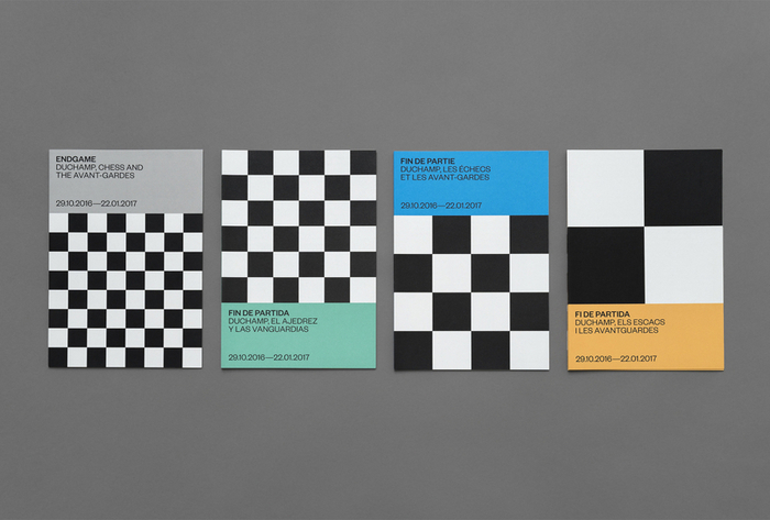 Exhibition flyers in four languages; English, Spanish, French, and Catalan