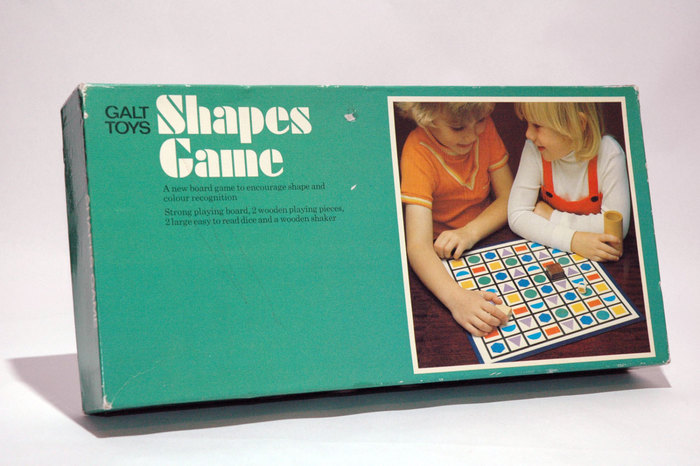 The designer of this box is unclear, but it seems to have been released during Garland's tenure.