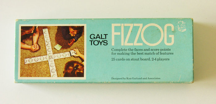 Ken Garland & Associates designed the original Fizzog matching game in 1969. This is a mid-1970s edition. The designer of this box is unclear, but it seems to have been released during Garland's tenure.
