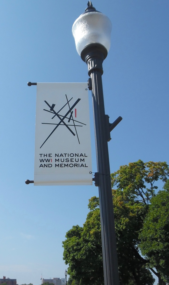 "In February 2017, the museum introduced a new logo. ""Titled 'Intersections,' [it] features nine intersecting lines that conjure a 'tangle' of images related to the war: barbed wire, railroad tracks, factories, beams of broken homes, the chaos of war. The logo [was] designed for free by St. Louis-based advertising agency Rodgers Townsend."" — The Kansas City Star"