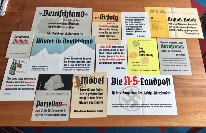 """This specimen of Deutschland's Plakat (poster) sizes contains twelve folded A3 and A2 sheets. Several of them are littered with Nazi propaganda — see the quote by Adolf Hitler, or the ad for the Nationalsozialistische Landpost, the organ of the Reichs-Nährstand, announcing a special """"Blood and Soil"""" issue of the Völkischer Beobachter, the newspaper of the Nazi Party notorious for their racist agitation."""