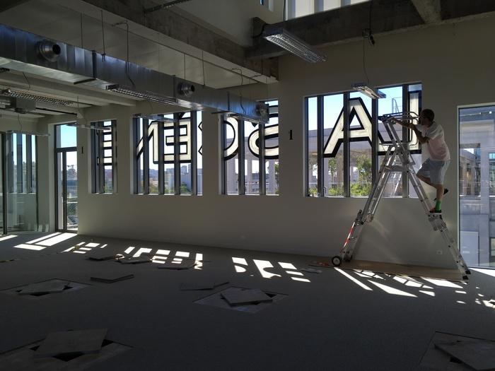 Magasins Généraux window signs 4