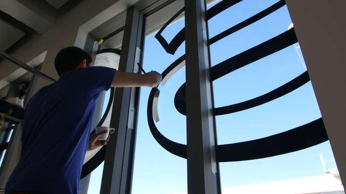 Magasins Généraux window signs 3