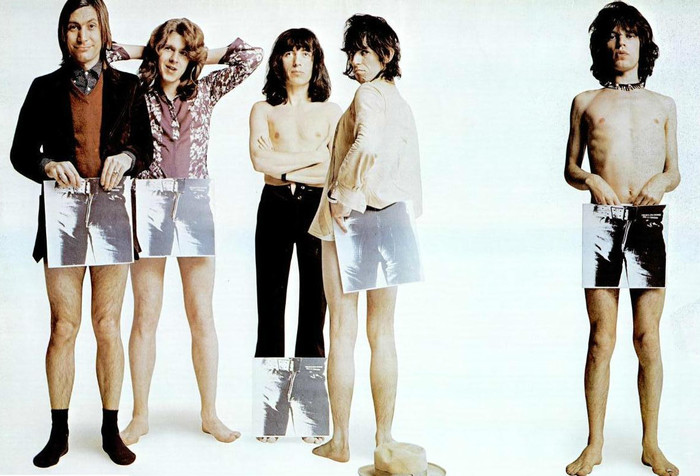 The Rolling Stones posing in an ad with covers of Sticky Fingers, with the original artwork, in 1971, from left to right: Charlie Watts, Mick Taylor, Bill Wyman, Keith Richards, and Mick Jagger