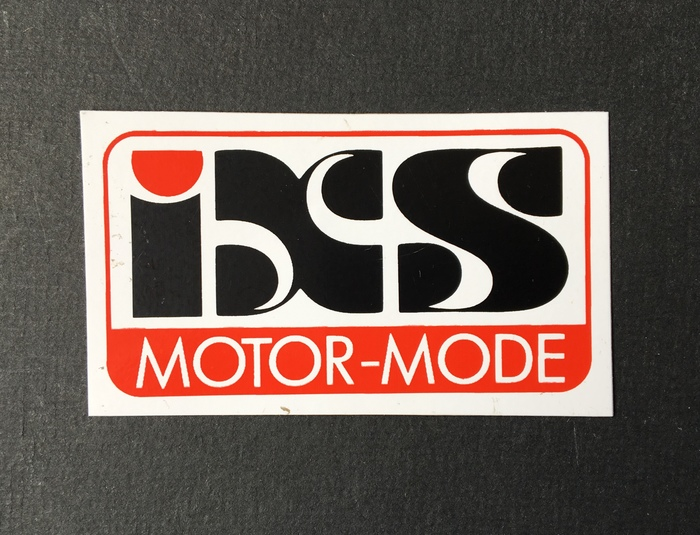 """A sticker and a patch (below) that probably date from the early days (late 1970s/early 1980s). """"Motor-Mode"""" is in  caps."""