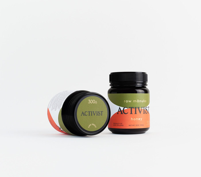 Gold foil elements appear on the body & lid labels