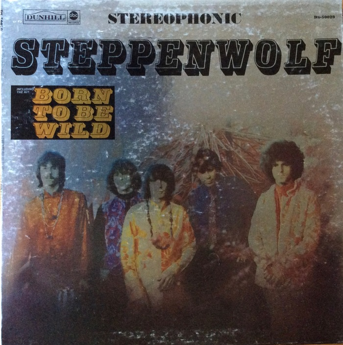 """Steppenwolf (Dunhill/ABC, USA, 1968). Cover design by Gary Burden, with photography by Tom Gundelfinger, printed on silver foil. Profil's letterforms are condensed. The box that names the hit song """"Born to Be Wild"""" shows the typeface's true proportions. It was added in later printings after the song hit the charts and was prominently featured in the movie Easy Rider (July 1969)."""