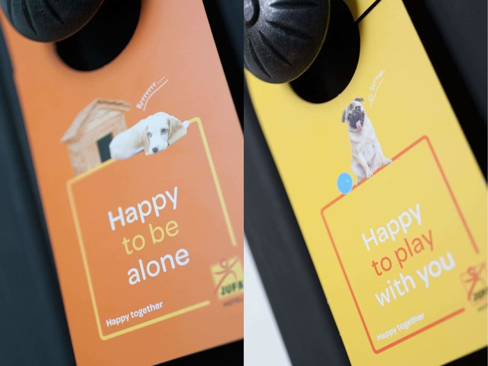 "The door hangers offer playful variations on JUFA's tagline ""Happy together""."
