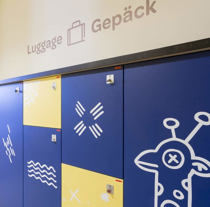 Omnes' low-contrast strokes with rounded terminals are reflected in the custom pictograms as well as the doodle-like locker decoration.