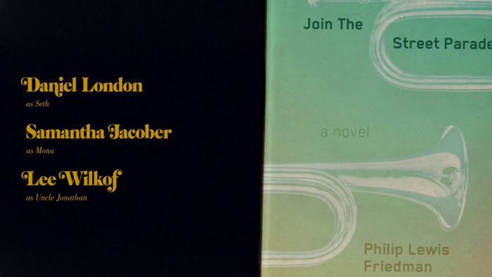 From the end titles: Philip Lewis Friedman, Join The Street Parade. The font is Blender.