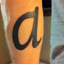 'a' tattoo