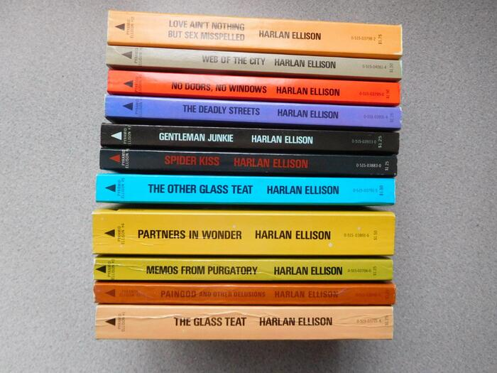 Book spines. The paperbacks come with green edges.