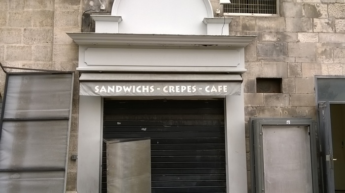 A sandwich café advertises in Lithos, a font that has come bundled with Adobe software for many years.