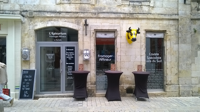 Fromagerie L'Épicurium offers cheese and wine. The type on the shop window is ITC Bauhaus.
