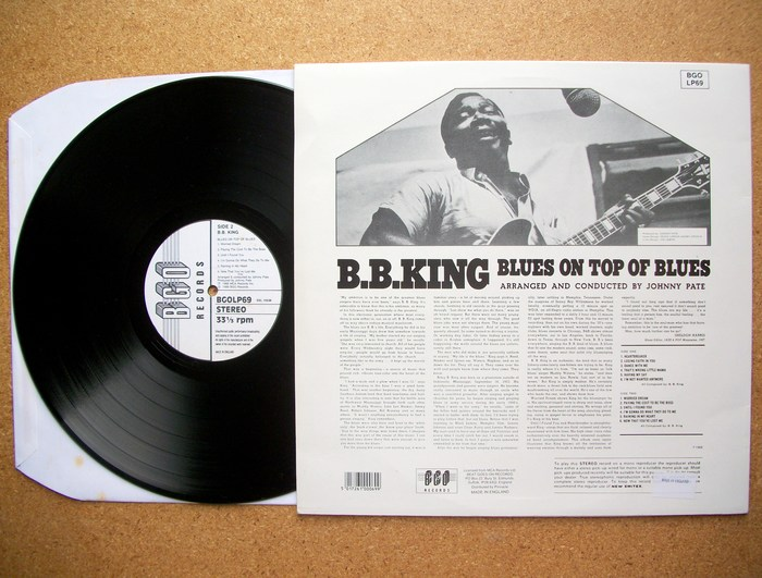 "The back cover features a number of other, less heavy slab serifs. ""B.B. King"" is Bartuska Breton. ""Arranged and conducted"" is set in Beton. The text typeface used for the liner notes appears to be a version of Stymie with its alternate monocular 'a'."
