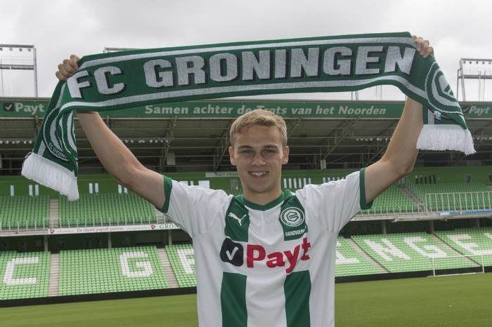 Note that the all around the upper edge of the stadium, the Payt logo is combined with tag lines (together behind the pride of the North, and We are Groningen) that seem to be set in Auto as well.