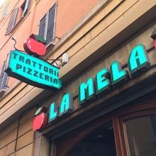 La Mela trattoria pizzeria signs