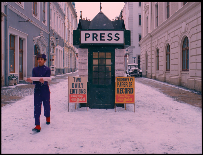 """The word """"PRESS"""" on the newsstand is written in FF DIN. The two signs below seem to use Toronto Gothic."""