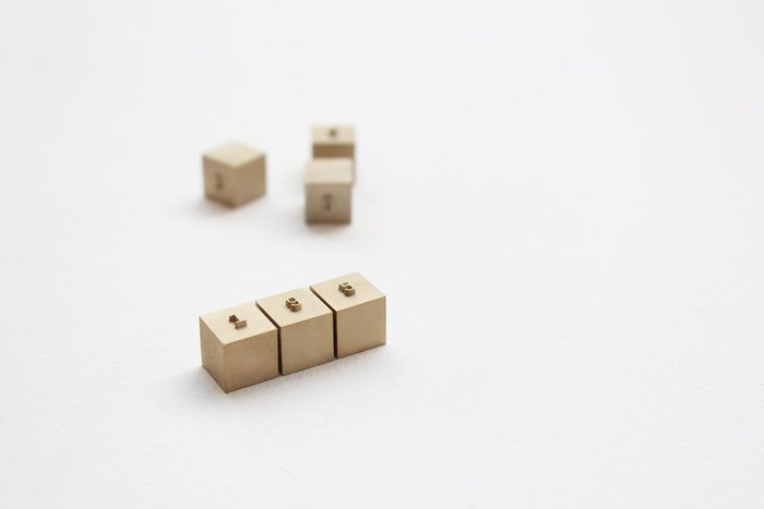 Solid brass price blocks, machined by a letterpress manufacturer in Geogrotesque.