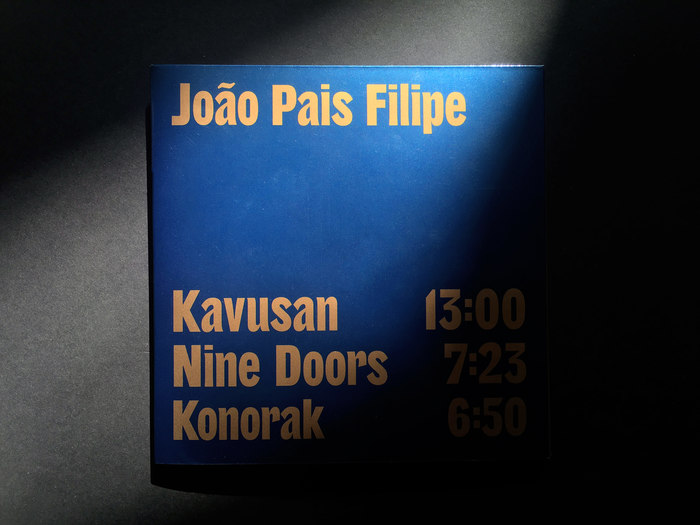 The track listing on the back cover uses custom lettering by Proto.