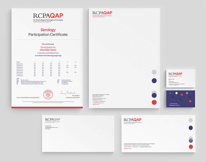 The branding elements—logo, the Omnes typeface, and dots in red, purple and grey—as applied to stationery items like certificates, letterheads, compliments slips, and business cards.