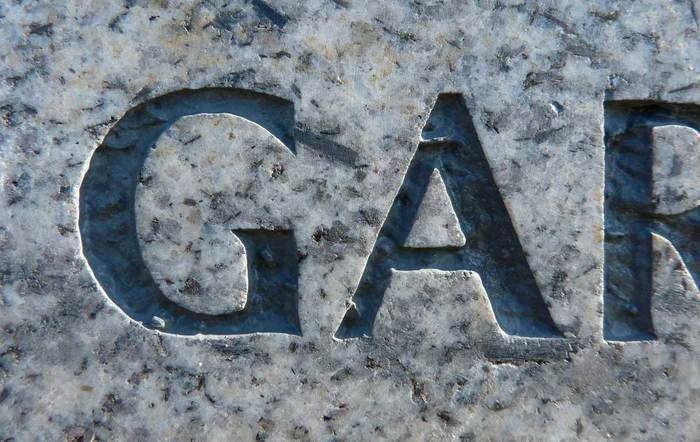"An example of an uppercase ""G"" and ""A"" carved in granite and infilled."