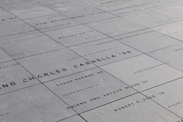 Donor signage on the building's roof terrace appears as a constellation of names engraved in granite.