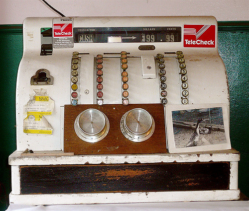 TeleCheck stickers on an old cash register at a butcher shop in Columbia City, Washington.