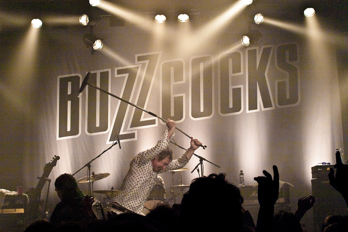 An outlined version of the logo, used as stage decoration at a Buzzcocks concert in 2010.