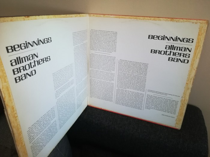 The liner notes are arranged in a peculiar symmetrical layout.