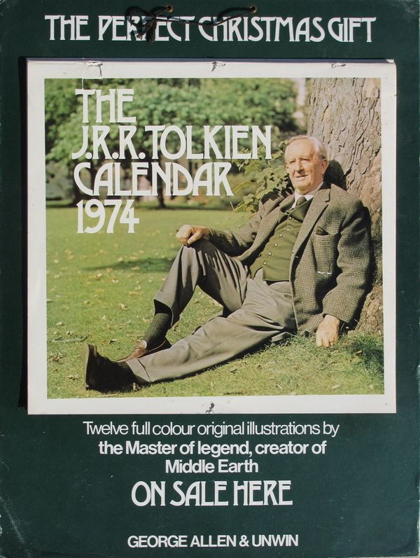 A store advertisement for The J.R.R. Tolkien calendar. Calendar attached to a heavy weight cardboard with fold-out stand on the back and black string for hanging.