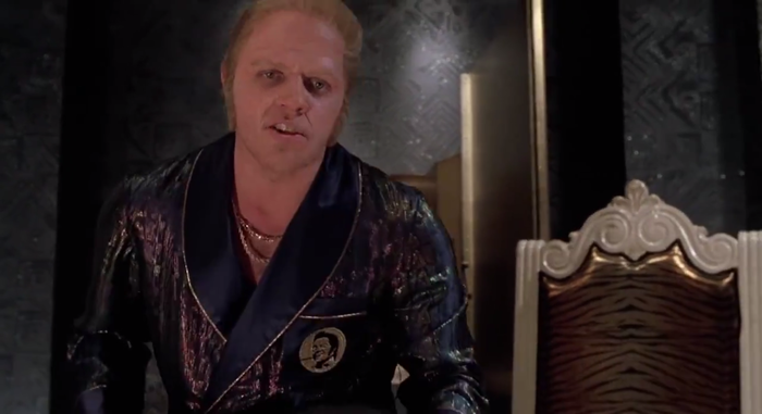 I was not able to find a more prominent instance of the specific logo, though the design with the circle with face on it was used on Biff's robe.
