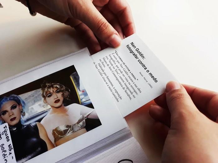 An article about photographer Nan Goldin, hidden by one of her photographs.