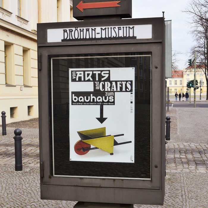 The third poster from the series, on display in front of the museum. It depicts Gerrit Thomas Rietveld's toy barrow, c.1920. Badisches Landesmuseum Karlsruhe, VG Bild-Kunst, Bonn 2019. Object photo: Thomas Goldschmidt.
