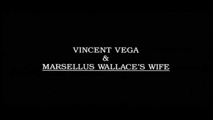 "Intertitle card, partially underlined: ""Vincent Vega & Marsellus Wallace's Wife"""