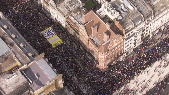 A large 'Put It To The People' banner was carried by the crowd.