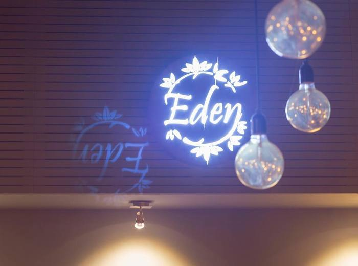 Illuminated logo inside the restaurant.