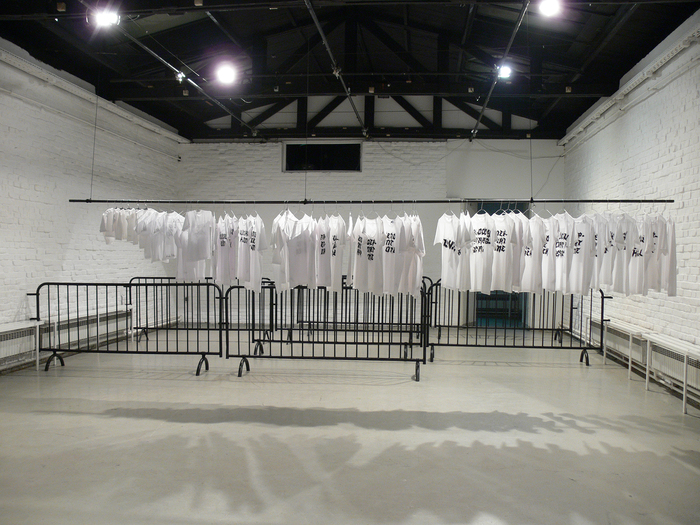 Nada Prlja — Strike. Installation, 2009. Industrial shirt railing, 10m, 70 hand painted T-shirts, 70 hangers. Image from the exhibition at MC Gallery, Zagreb, Croatia, 2009. Courtesy the artist