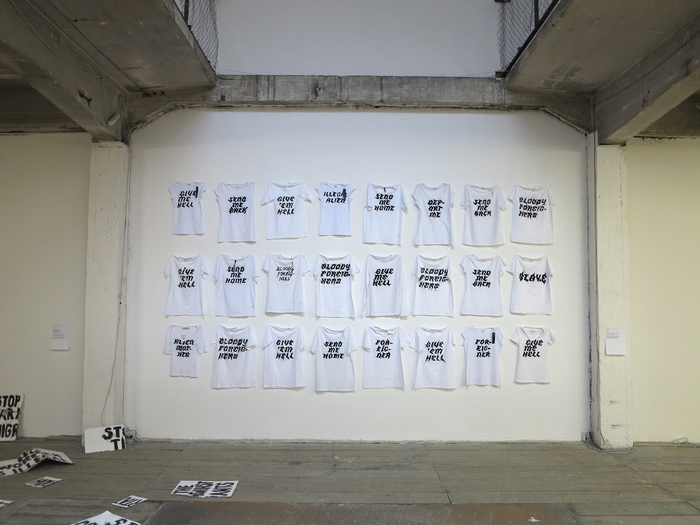 Nada Prlja —Strike. Installation, 2013. 24 hand painted T-shirts. Image from the solo exhibition at FUTURA Center for Contemporary Art, Praha. Courtesy of the artist.