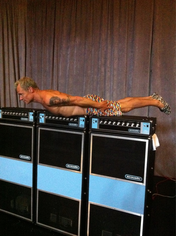 """Flea, a big fan of Jaco Pastorius, is seen here """"planking"""" on three Acoustic 361 stacks made by the shortlived Acoustic USA."""