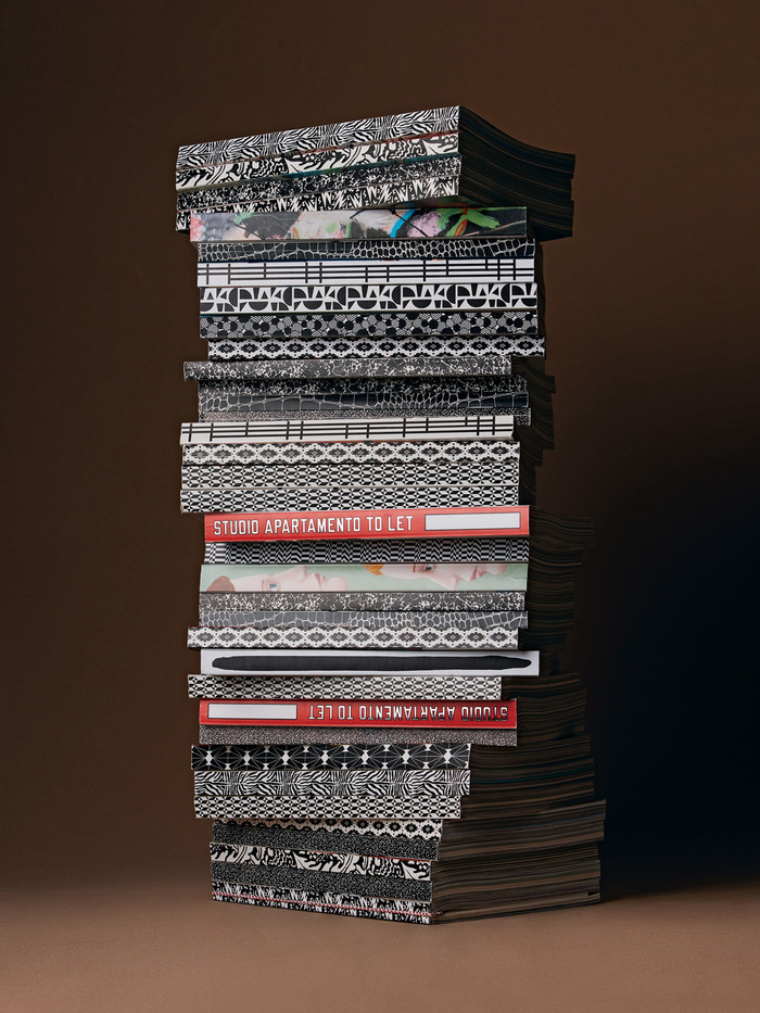 Apartamento's spines are typically decorated with patterns, except for the tenth anniversary issue, which sports a lettering by artist Lawrence Weiner.