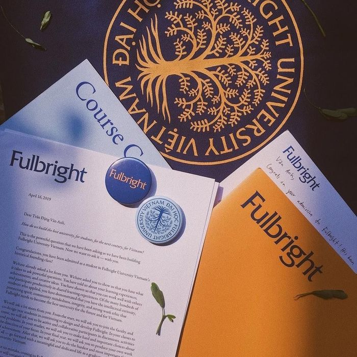 Stationery, buttons, and other items featuring the Fulbright logo and the university's seal with .