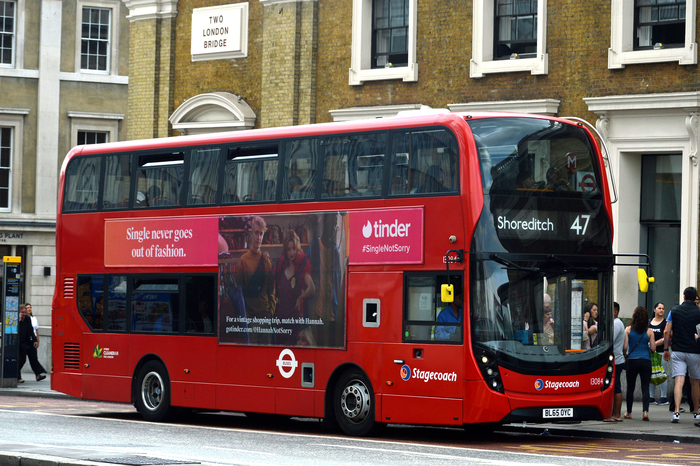 Tinder ad on a double decker bus in London.