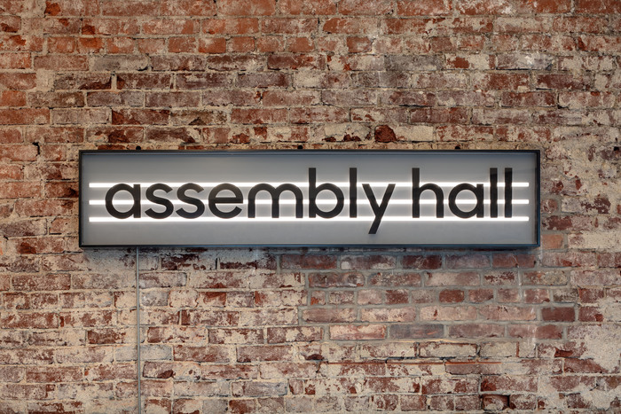 The signs are designed in strong, simple black and white, with an outline that sets them apart from everything around them. Key signage is fabricated from giant LED bulbs inset in boxes, overlaid with type.