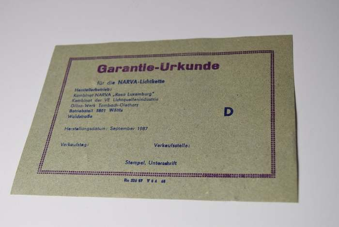 Like many items printed in the GDR, the enclosed certificate of guarantee looks like it is from the 1950s, or even older. In fact, it is letterpress-printed, but wasn't issued any earlier than 1987. The fonts in use are a version of  fett (first cast in 1909, also carried by Schriftguss in Dresden as Neptun, and later listed under the generic name Grotesk in an early Typoart specimen) and  (1930).