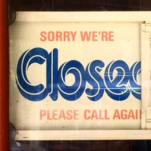 Closed/Open sign with slotted board