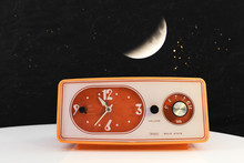 Sears solid state clock radio in orange