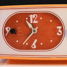 Sears solid state clock radio in orange