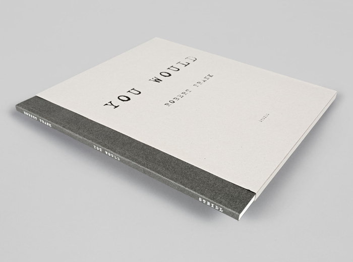 The slipcase shows a reversed, positive version of the cover design.