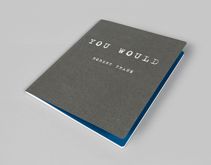 The textured cover in warm grey is followed by blue endpapers.